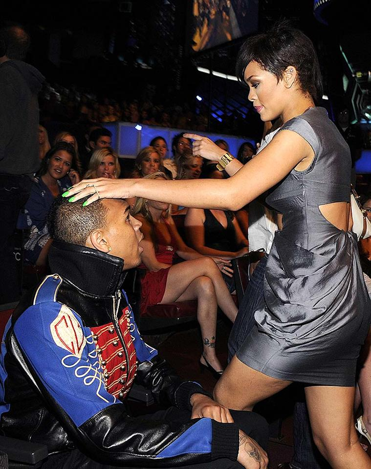 "Rihanna rubbed her main squeeze Chris Brown's head for good luck. The R and B star challenged host Mike Myers to a dance-off during the show. Kevin Mazur/<a href=""http://www.wireimage.com"" target=""new"">WireImage.com</a> - June 1, 2008"
