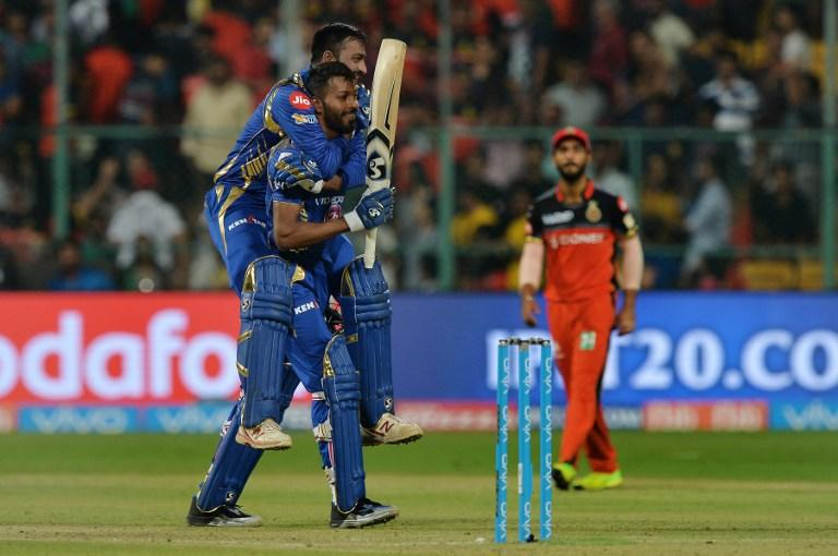 <p>Mumbai Indians batsman Krunal Pandya (TOP) jumps on teammate Hardik Pandya as they celebrate their team's victory in the the 2017 Indian Premier League (IPL) Twenty20 cricket match between Royal Challengers Bangalore and Mumbai Indians at The M.Chinnaswamy Stadium in Bangalore on April 14, 2017. ——IMAGE RESTRICTED TO EDITORIAL USE – STRICTLY NO COMMERCIAL USE—– / GETTYOUT—— / AFP PHOTO / Manjunath KIRAN / —-IMAGE RESTRICTED TO EDITORIAL USE – STRICTLY NO COMMERCIAL USE—– / GETTYOUT </p>