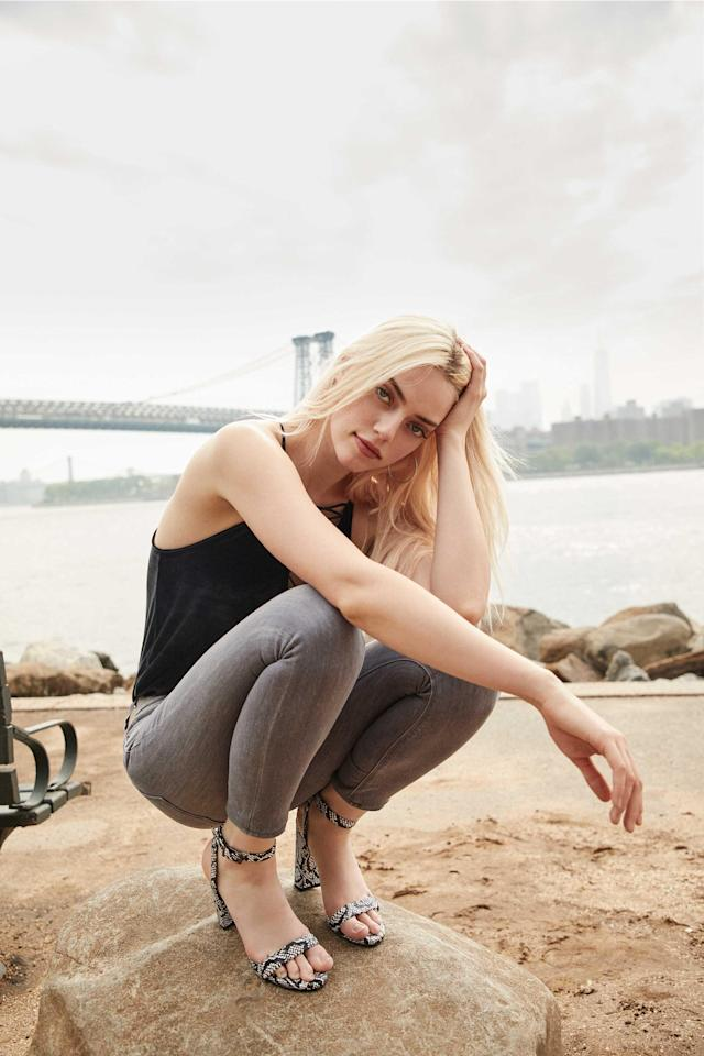 Pyper America Smith wears gray skinny Express jeans with a black tank and heel sandals. (Photo: Courtesy of Express)