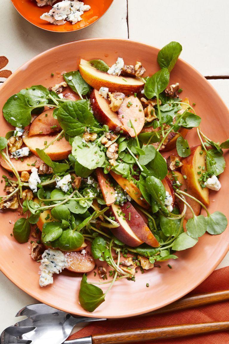 """<p>A little sweet, a little salty, and a little crunchy. What more could you possibly want from a salad? <br></p><p><em><a href=""""https://www.womansday.com/food-recipes/food-drinks/a22476568/peach-blue-cheese-and-walnut-salad-recipe/"""" rel=""""nofollow noopener"""" target=""""_blank"""" data-ylk=""""slk:Get the Peach, Blue Cheese, and Walnut Salad recipe."""" class=""""link rapid-noclick-resp"""">Get the Peach, Blue Cheese, and Walnut Salad recipe.</a></em></p>"""
