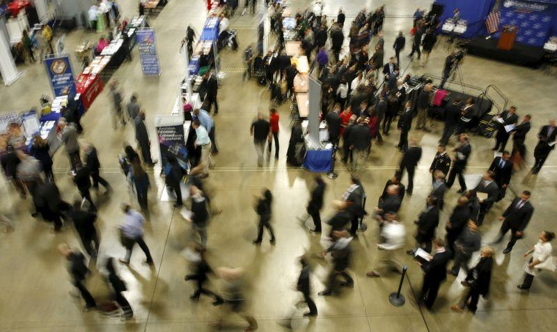 "FILE PHOTO: Job seekers break out to visit employment personnel at ""Hiring Our Heroes"" military job fair in Washington"