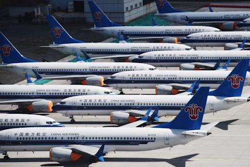 Boeing 737 MAX aircraft bearing China Southern's livery parked in a line at Urumqi airport, in China's western Xinjiiang region on June 5, 2019. Photo: AFP