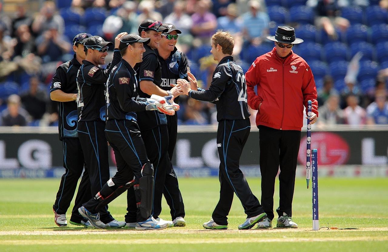 New Zealand's Kane Williamson (second right) is congratulated by his team mates after running out Sri Lanka's Lahiru Thirimanne (not pictured) during the ICC Champions Trophy match at the SWALEC Stadium, Cardiff.