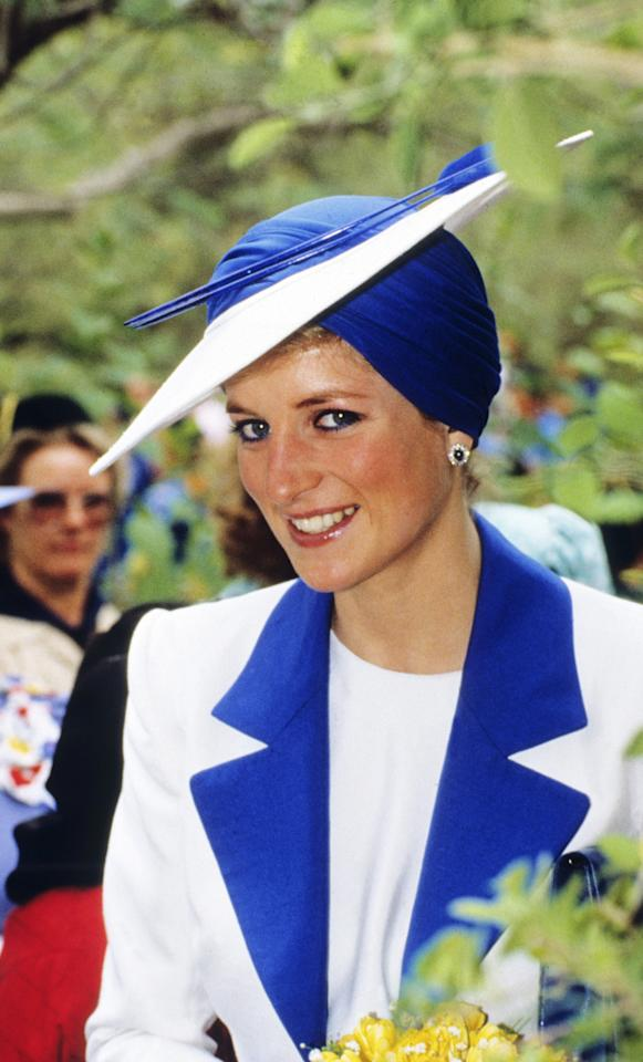 <p>Here, the Princess matched her eye color to an over-the-top Philip Somerville turban hat during a 1989 visit to Dubai. (Photo: Anwar Hussein/WireImage) </p>