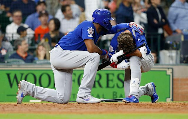 Albert Almora Jr. is comforted by Jason Heyward after a young child was injured by a foul ball off his bat in the fourth inning on Wednesday night. (Getty Images)