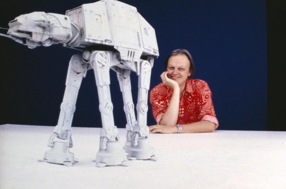 Dennis Muren poses with an AT-AT walker behind the scenes of <em>The Empire Strikes Back</em>. (Photo: Lucasfilm)