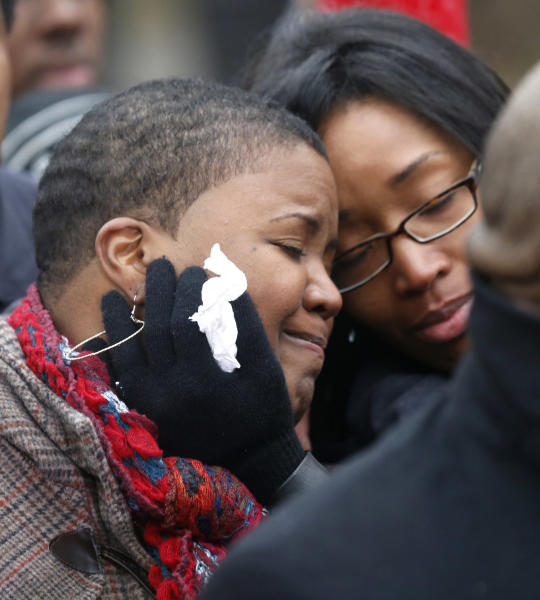 Cleopatra Pendleton, left, is consoled by her sister Kimiko Pettis, during a news conference with Chicago Police Superintendent Garry McCarthy seeking help from the public in solving the murder of Pendleton's daughter Hadiya Wednesday, Jan. 30, 2013, in Chicago. Hadiya, 15, who had performed in President Barack Obama's inauguration festivities, was killed in a Chicago park as she talked with friends by a gunman who apparently was not even aiming at her. The city's 42nd slaying is part of Chicago's bloodiest January in more than a decade, following on the heels of 2012, which ended with more than 500 homicides for the first time since 2008. It also comes at a time when Obama, spurred by the Connecticut elementary school massacre in December, is actively pushing for tougher gun laws. (AP Photo/Charles Rex Arbogast)
