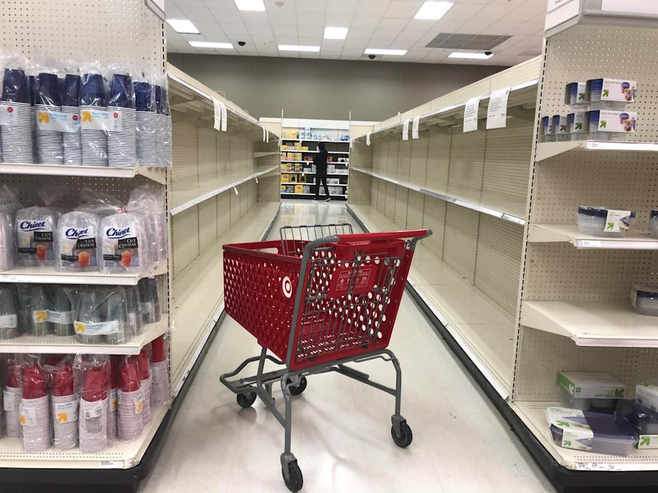 An abandoned shopping cart lies between empty paper towel aisles during coronavirus disease (COVID-19) related hoarding at a Target store in Culver City, California, U.S., April 2, 2020. Picture taken April 2, 2020.   REUTERS/Lisa Baertlein