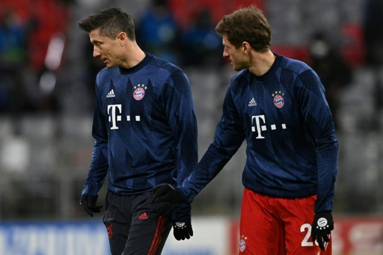 Mueller (R) admits the loss of top-scorer Lewandowski (L) to injury is 'bad timing' for the club world champions