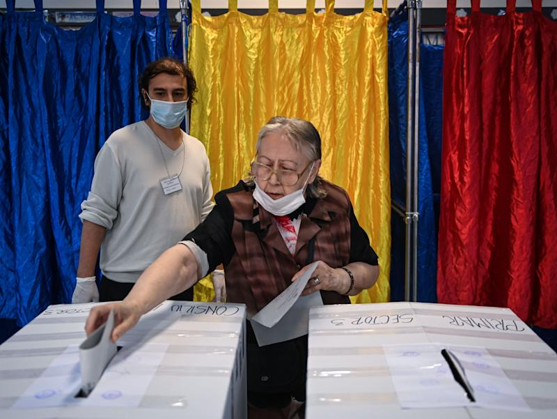 A voter casts a ballot at a polling station in Bucharest on Sunday (AFP via Getty Images)