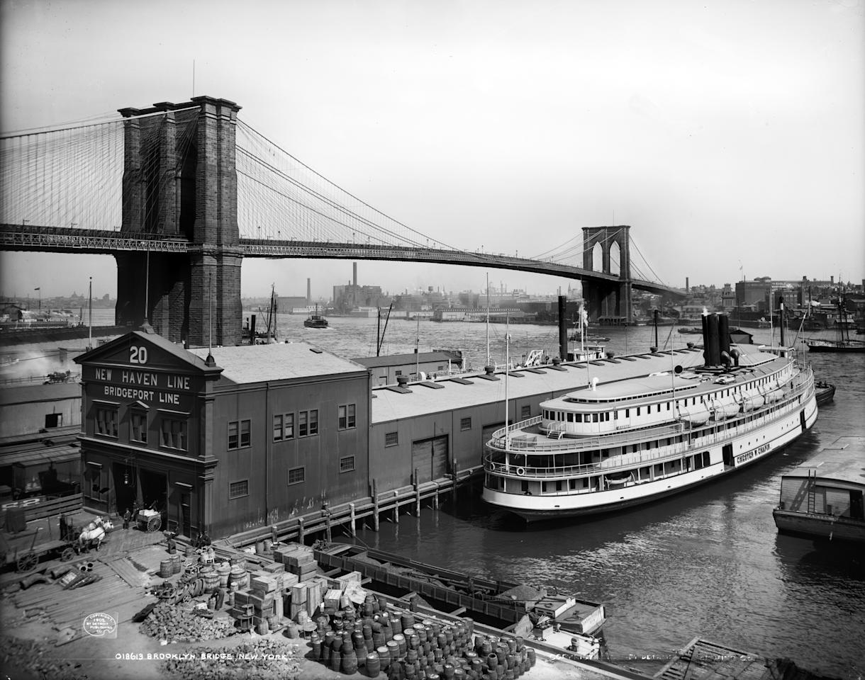 The steamboat Chester W. Chapin docks at a pier in the East River near the Brooklyn Bridge in New York, ca. 1905. (AP Photo/Library of Congress)