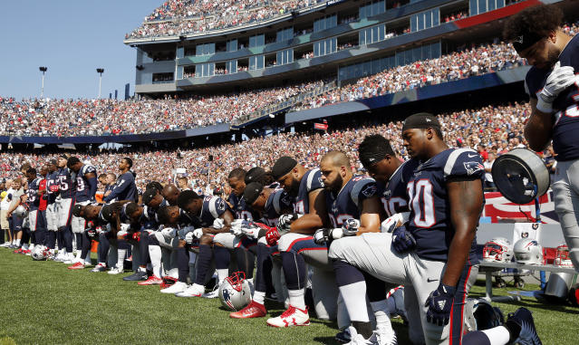 <p>Several New England Patriots players kneel during the national anthem before an NFL football game against the Houston Texans, Sunday, Sept. 24, 2017, in Foxborough, Mass. (AP Photo/Michael Dwyer) </p>