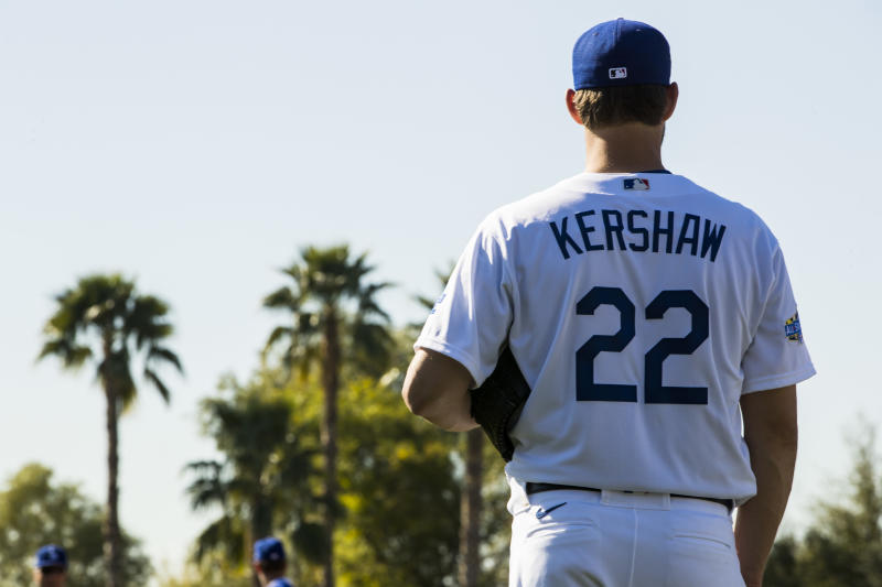 GLENDALE, AZ - FEBRUARY 20: Clayton Kershaw #22 of the Los Angeles Dodgers looks on during a workout after Photo Day on Thursday, February 20, 2020 at Camelback Ranch in Glendale, Arizona. (Photo by Adam Glanzman/MLB Photos via Getty Images)