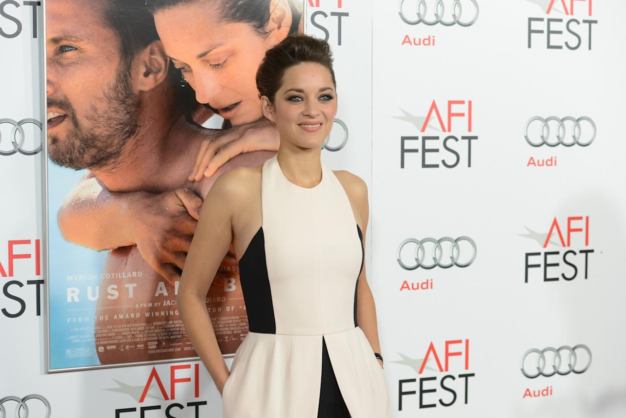 HOLLYWOOD, CA - NOVEMBER 05:  Actress Marion Cotillard arrives at the premiere of 'Rust and Bone' during the 2012 AFI Fest presented by Audi at Grauman's Chinese Theatre on November 5, 2012 in Hollywood, California.  (Photo by Jason Merritt/Getty Images)
