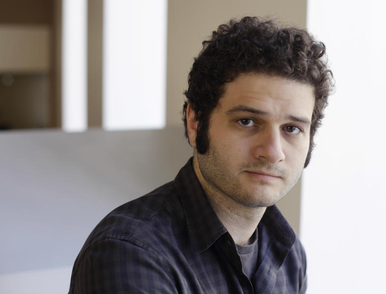 In this photo taken Thursday April 26, 2012, Dustin Moskovitz co-founder of the collaborative software companay Asana, poses outside of his office in San Francisco. Facebook co-founder and former Mark Zuckerberg roommate Dustin Moskovitz is by many accounts the world's youngest self-made billionaire. But the 27-year-old isn't sipping champagne in the Caribbean. Instead he's thrown himself back into San Francisco's startup churn with an online collaboration app he says will become the world's next $100 billion company. (AP Photo/Eric Risberg)