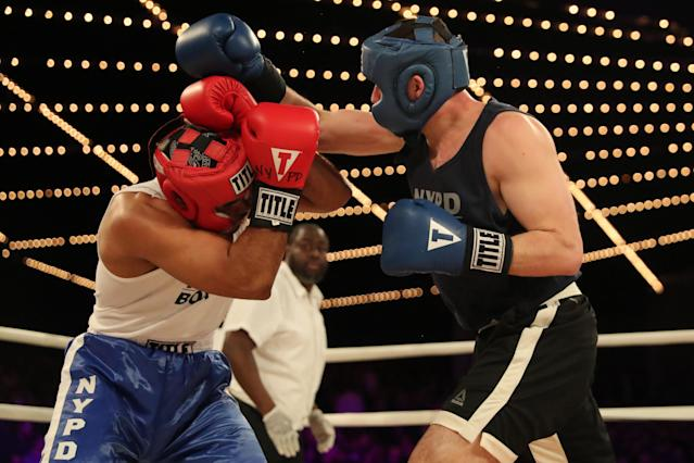 <p>Anthony Davilla (red) of the 79th Precinct in Brooklyn covers as cadet Paul Altamore (blue) throws a punch in the Brooklyn vs. Police Academy match during the NYPD Boxing Championships at the Hulu Theater at Madison Square Garden on March 15, 2018. (Gordon Donovan/Yahoo News) </p>