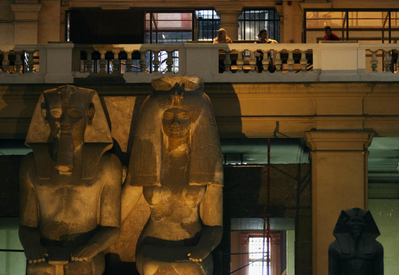 Guests participating in a tour walk around the Egyptian Museum after its renovation project announcement in downtown Cairo, Egypt, Friday, Nov. 15, 2013. Egypt unveiled Friday an ambitious renovation project for its Cairo's famed Egyptian Museum, in a bid to show that the Arab world's most populous country was regaining a sense of normalcy after months of unrest. (AP Photo/Hiro Komae)