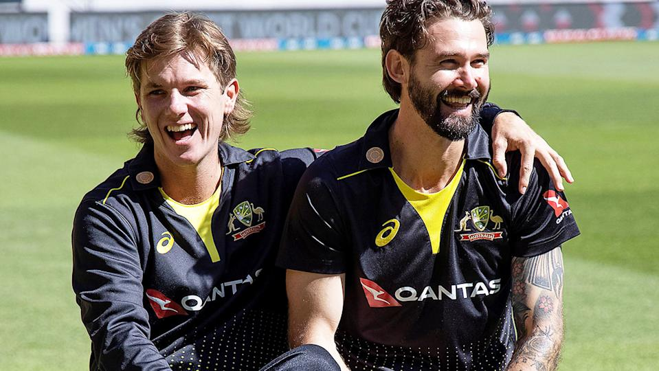 Adam Zampa and Kane Richardson, pictured here posing for a team photo.