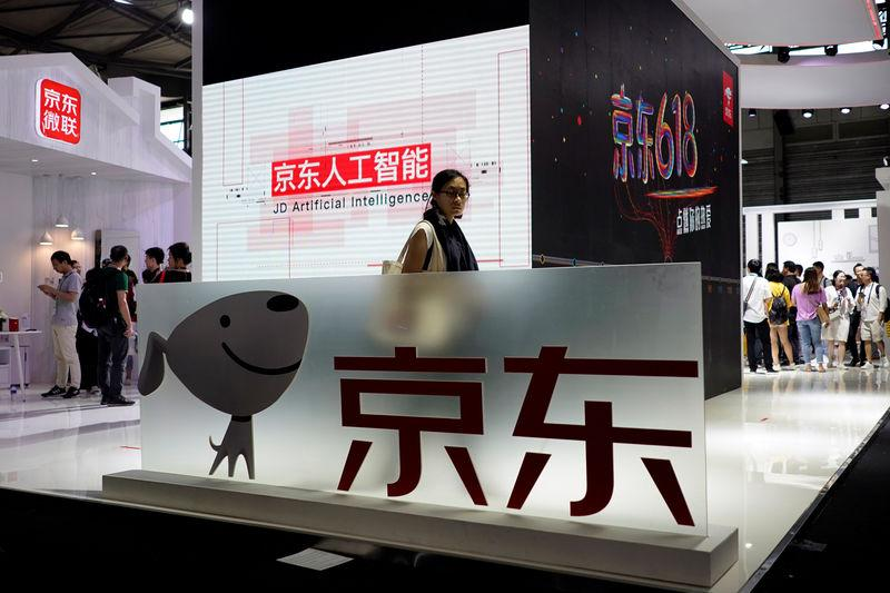 A sign of China's e-commerce company JD.com is seen at CES (Consumer Electronics Show) Asia 2018 in Shanghai