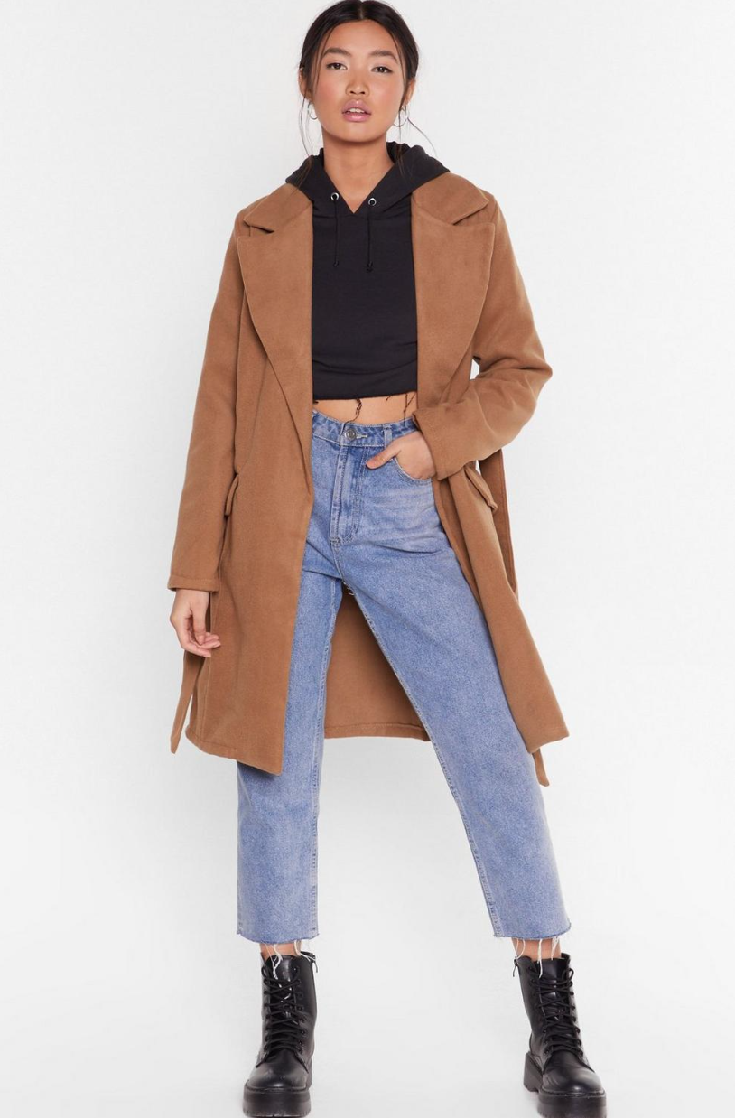 "<p><strong>Nasty Gal</strong></p><p>nastygal.com</p><p><strong>$35.60</strong></p><p><a href=""https://go.redirectingat.com?id=74968X1596630&url=https%3A%2F%2Fwww.nastygal.com%2Fca%2Fgrab-your-faux-wool-coat%2FAGG57417.html&sref=https%3A%2F%2Fwww.cosmopolitan.com%2Fstyle-beauty%2Ffashion%2Fg32789799%2Fbest-camel-coat%2F"" rel=""nofollow noopener"" target=""_blank"" data-ylk=""slk:Shop Now"" class=""link rapid-noclick-resp"">Shop Now</a></p><p>Layer this trench with a cropped hoodie underneath for an outfit perfect for a chilly October day. </p>"