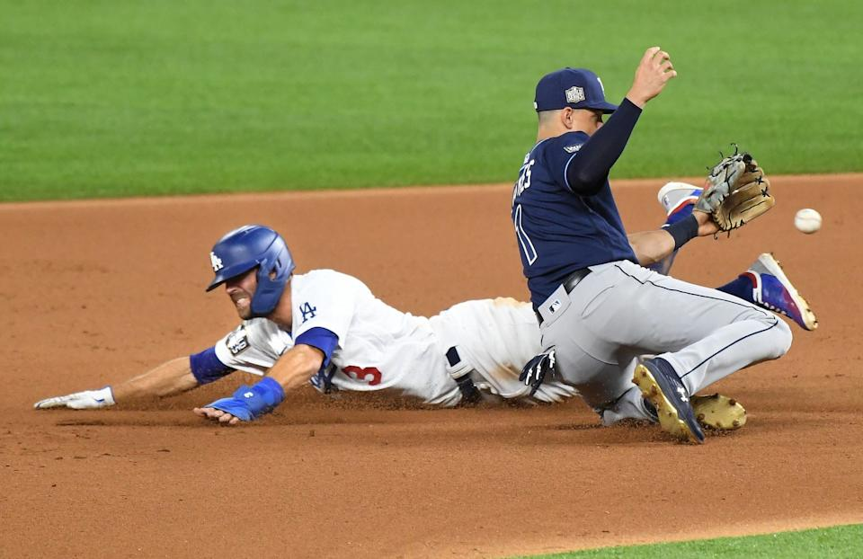 Chris Taylor beats the tag of Rays shortstop Will Adames in the fourth inning.