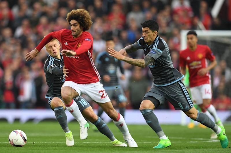 Manchester United's Marouane Fellaini vies with Celta Vigo's Daniel Wass (L) and Pedro Pablo Hernandez (2nd R) during their UEFA Europa League semi-final, second-leg football match on May 11, 2017 (AFP Photo/Paul ELLIS)