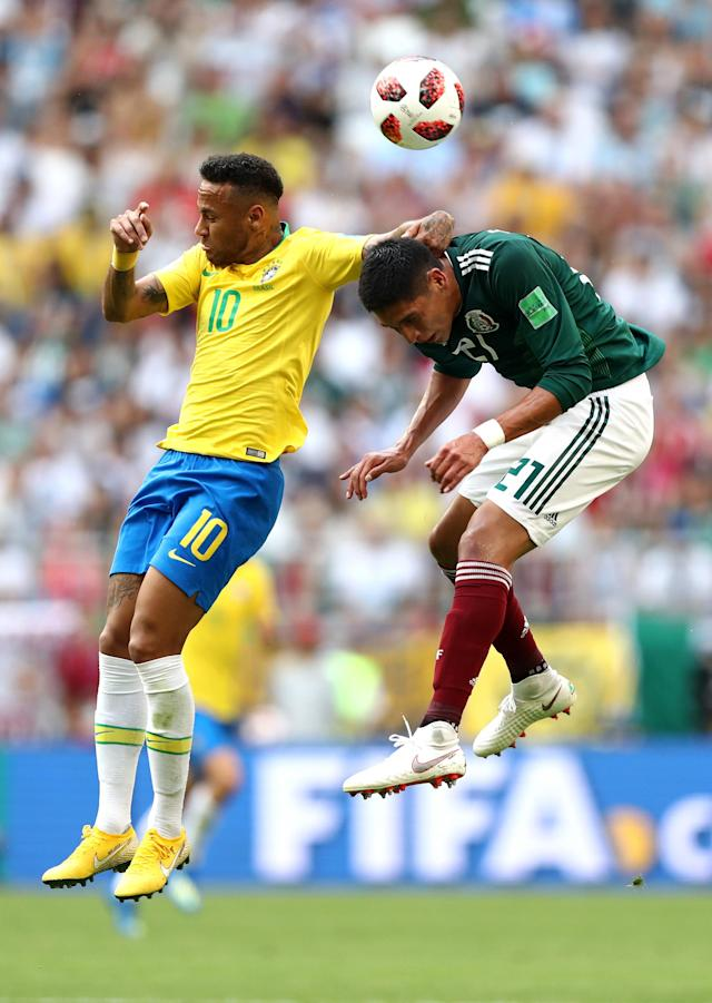 <p>Neymar Jr wins a header over Edson Alvarez of Mexico during the 2018 FIFA World Cup Russia Round of 16 match between Brazil and Mexico at Samara Arena on July 2, 2018 in Samara, Russia. (Photo by Ryan Pierse/Getty Images) </p>