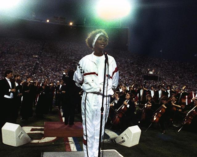 Singer Whitney Houston lip syncs the National Anthem before Super Bowl XXV January 27, 1991 in Tampa. The New York Giants defeated the Buffalo Bills before 73,813 fans at Tampa Stadium. (Photo by Al Messerschmidt/Getty Images)