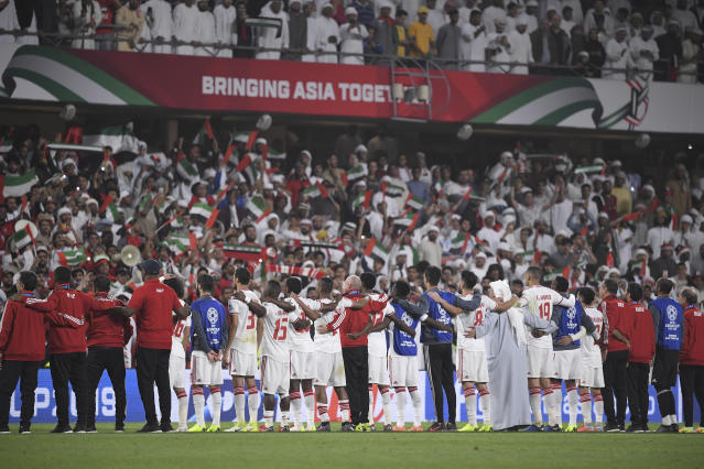 United Arab Emirates's soccer team celebrate at the end of the AFC Asian Cup quarterfinal soccer match against Australia at Hazza Bin Zayed Stadium in Al Ain, United Arab Emirates, Friday, Jan. 25, 2019. United Arab Emirates won 1-0. (AP Photo/Hassan Ammar)