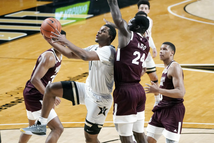 Vanderbilt guard Jordan Wright drives against Mississippi State forward Abdul Ado (24) in the first half of an NCAA college basketball game Saturday, Jan. 9, 2021, in Nashville, Tenn. (AP Photo/Mark Humphrey)
