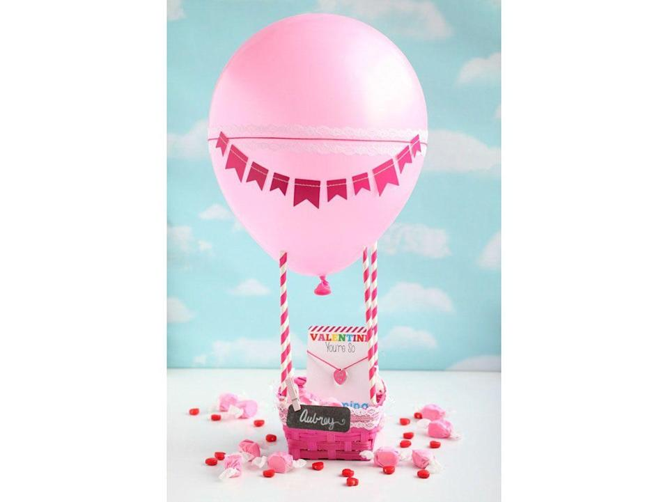 "<p>The sky's the limit when it comes to card boxes, and this hot air balloon basket takes the craft to a whole other level.</p><p><strong>Get the tutorial at <a href=""https://gigglesgalore.net/hot-air-balloon-valentine-box"" rel=""nofollow noopener"" target=""_blank"" data-ylk=""slk:Giggles Galore"" class=""link rapid-noclick-resp"">Giggles Galore</a>.</strong></p><p><strong><a class=""link rapid-noclick-resp"" href=""https://www.amazon.com/Fuchsia-Pink-Striped-Paper-Straws/dp/B00I9I9WZO?tag=syn-yahoo-20&ascsubtag=%5Bartid%7C10050.g.25844424%5Bsrc%7Cyahoo-us"" rel=""nofollow noopener"" target=""_blank"" data-ylk=""slk:SHOP STRAWS"">SHOP STRAWS</a><br></strong></p>"