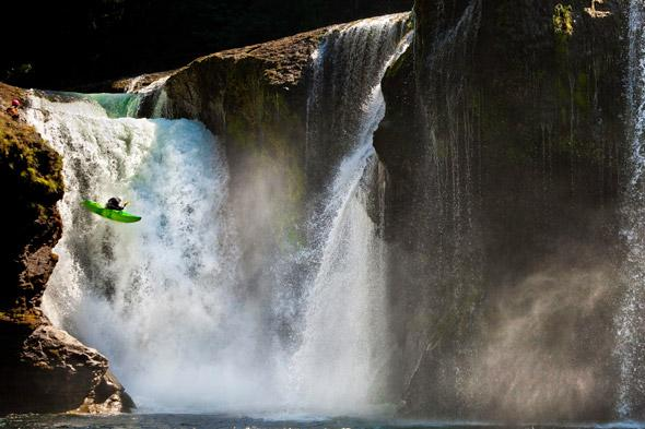 Daredevil kayakers left up a creek without a paddle as waterfall jump smashes oars
