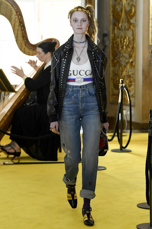 <p>A model in the latest Gucci must have tee and jeans combination walks the runway in Florence for Gucci's Resort 2018 show. (Photo: Getty Images) </p>