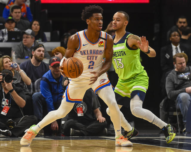 Oklahoma City Thunder guard Shai Gilgeous-Alexander(2) looks to pass the ball while defended by Minnesota Timberwolves guard Shabazz Napier(13) during the first half of an NBA basketball game Saturday, Jan. 25, 2020, in Minneapolis. (AP Photo/Craig Lassig)
