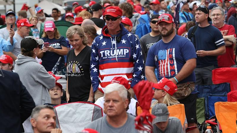 Supporters of US President Donald Trump gather to attend his campaign rally later at the BOK Center, June 20, 2020 in Tulsa, Oklahoma