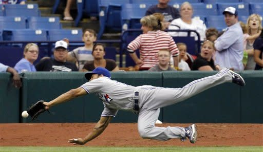 Toronto Blue Jays left fielder Eric Thames dives but can't come up with a sixth-inning foul ball by Tampa Bay Rays' Will Rhymes during a baseball game, Wednesday, May 23, 2012, in St. Petersburg, Fla. (AP Photo/Chris O'Meara)