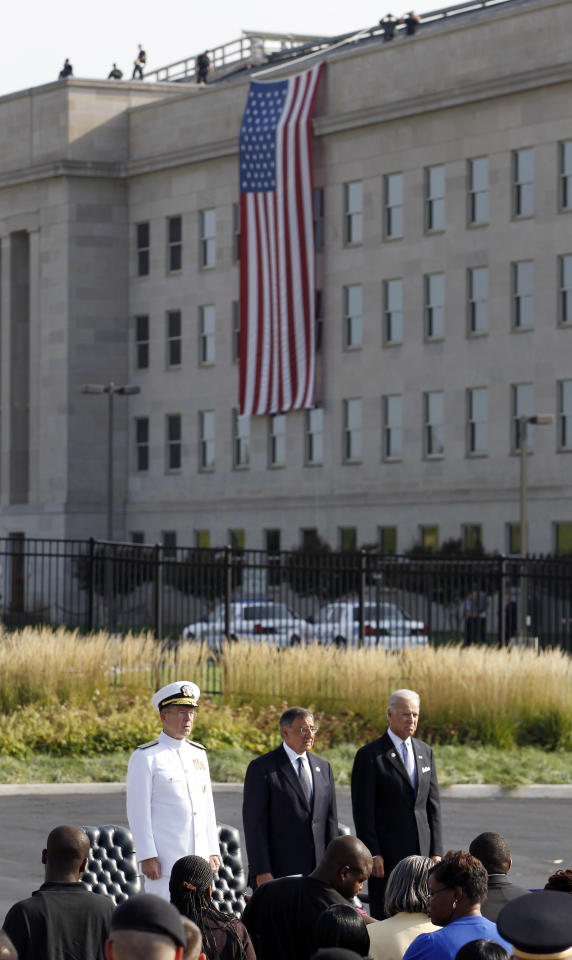 Chairman of the Joint Chiefs of Staff Adm. Mike Mullen, from left, Defense Secretary Leon Panetta, and Vice President Joe Biden stand during the playing of the National Anthem on the 10th anniversary of the September 11 attacks at the Pentagon in Washington, Sunday, Sept. 11, 2011. (AP Photo/Charles Dharapak)