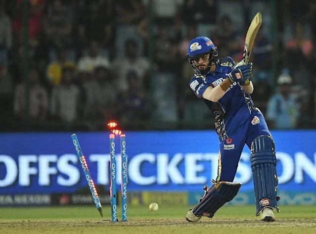 High-octane cricket: Mumbai Indians batter Mayank Markande is bowled out in a flurry of flashing lights against Delhi Daredevils on Sunday (AFP Photo/PRAKASH SINGH)