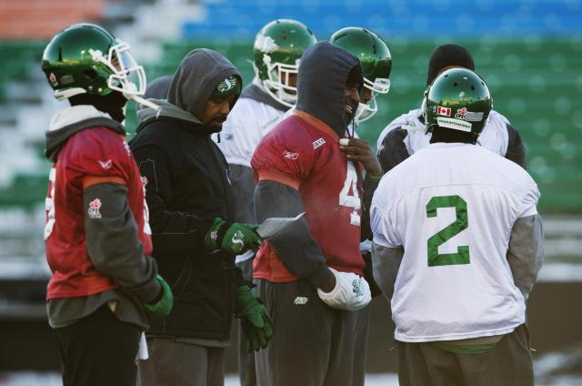Saskatchewan Roughriders quarterback Darian Durant (4) stands with his teammates during practice in Regina, Saskatchewan, November 22, 2013. The Saskatchewan Roughriders will play against the Hamilton Tiger-Cats in the CFL's 101st Grey Cup in Regina. REUTERS/Mark Blinch (CANADA - Tags: SPORT FOOTBALL)
