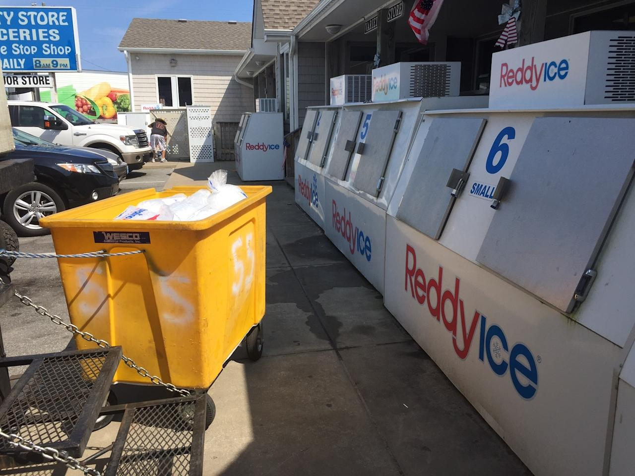 Ice is displayed at the Variety Store on Thursday, July 27, 2017, on Ocracoke Island on North Carolina's Outer Banks. An estimated 10,000 tourists were ordered Thursday to evacuate the island after a construction company caused a power outage, leaving people stranded without air conditioning or places to eat. (C. Leinbach/Ocracoke Observer via AP)