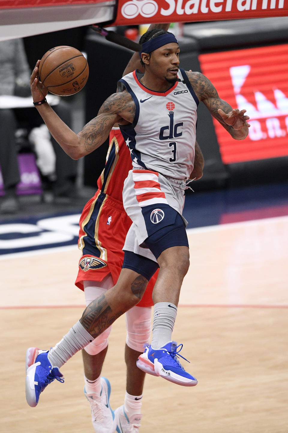 Washington Wizards guard Bradley Beal (3) looks to pass next to New Orleans Pelicans forward Naji Marshall, back, during the first half of an NBA basketball game Friday, April 16, 2021, in Washington. (AP Photo/Nick Wass)