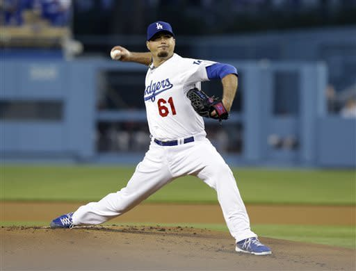 Los Angeles Dodgers starter Josh Beckett pitches to the San Francisco Giants in the first inning of a baseball game in Los Angeles, Wednesday, April 3, 2013. (AP Photo/Reed Saxon)