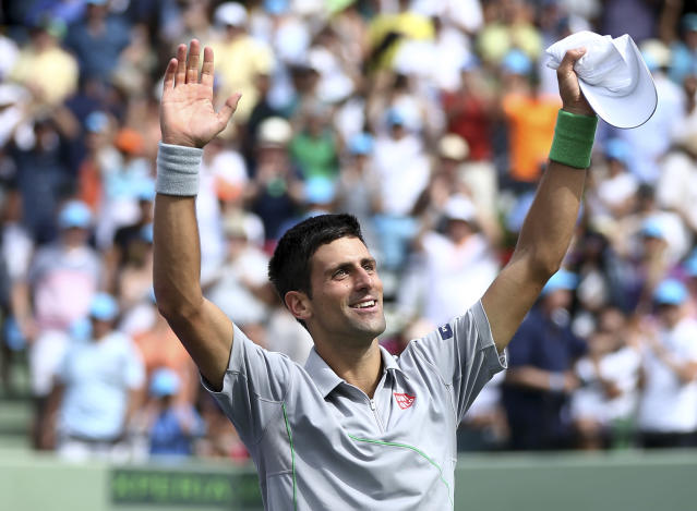 Novak Djokovic, of Serbia, waves after defeating Rafael Nadal, of Spain, 6-3, 6-3 during the men's final at the Sony Open Tennis tournament on Sunday, March 30, 2014, in Key Biscayne, Fla. ( AP Photo/J Pat Carter)