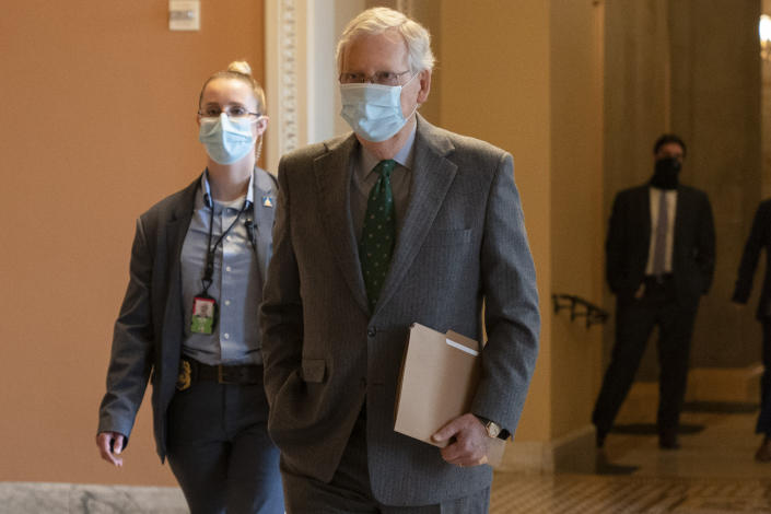 In this Oct. 21, 2020, photo, Senate Majority Leader Mitch McConnell of Ky., walks to the Senate Chamber on Capitol Hill in Washington. McConnell says there's nothing the public needs to know about his health after photos showed what appears to be bruising on his hands and around his mouth. (AP Photo/Jacquelyn Martin)