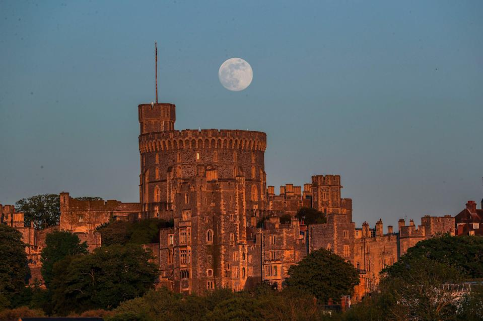 <p>A Supermoon rises above Windsor Castle last year</p> (PA)