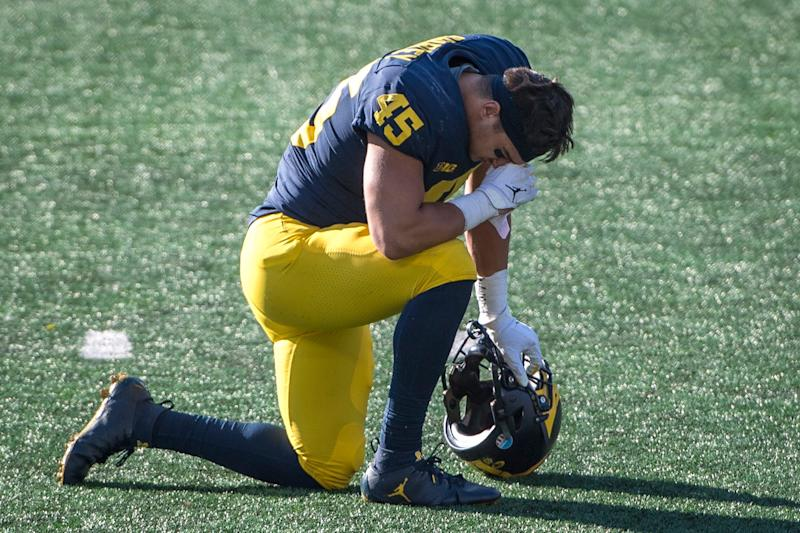 Adam Shibley of the Michigan Wolverines takes a knee after Michigan lost to the Michigan State Spartans at Michigan Stadium on Oct. 31, 2020, in Ann Arbor.