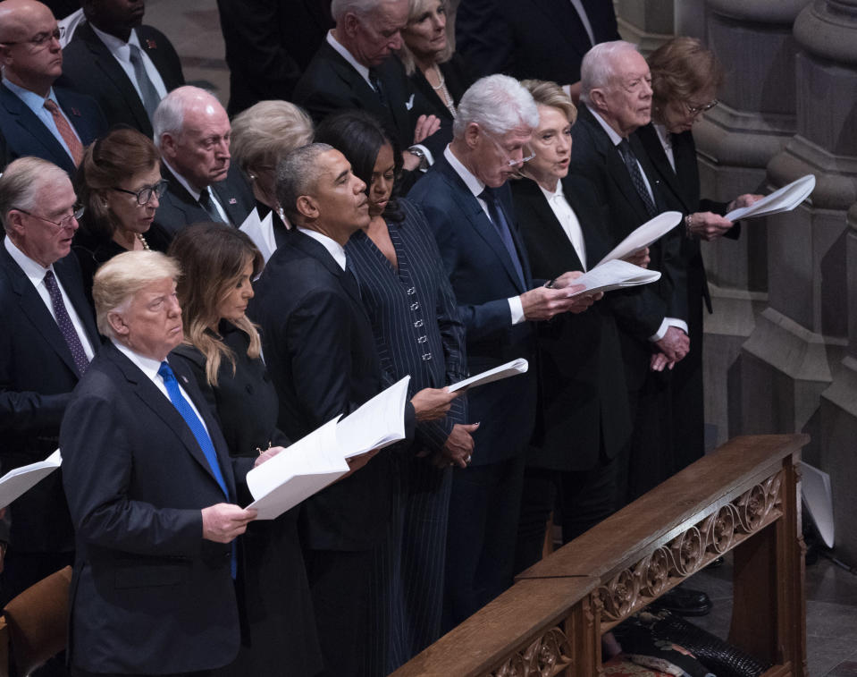 WASHINGTON, DC – DECEMBER 05: (AFP- OUT) United States President Donald J. Trump, First Lady Melania Trump, Barack Obama, Michelle Obama, Bill Clinton, Hillary Clinton, Jimmy Carter and Rosalyn Carter attend the state funeral service of former President George W. Bush at the National Cathedral, December 5, 2018 in Washington, DC. President Bush will be buried at his final resting place at the George H.W. Bush Presidential Library at Texas A&M University in College Station, Texas. A WWII combat veteran, Bush served as a member of Congress from Texas, ambassador to the United Nations, director of the CIA, vice president and 41st president of the United States. (Photo by Chris Kleponis-Pool/Getty Images)