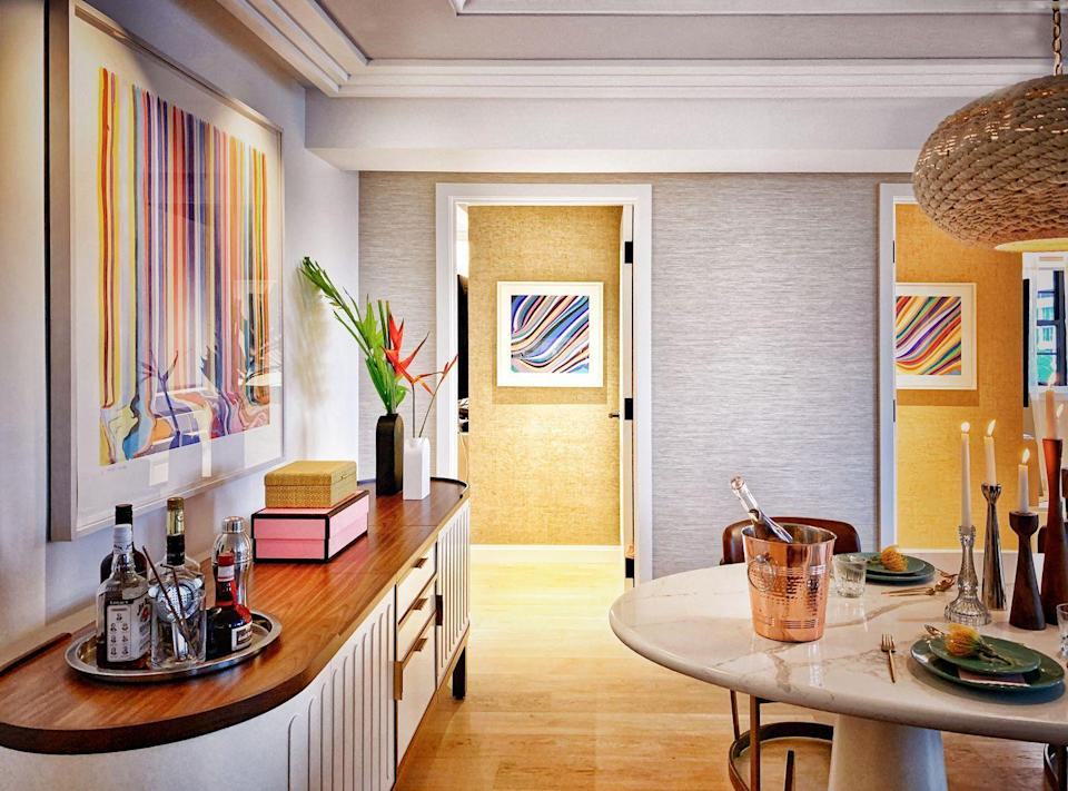 """<p><strong>What are your best tips for helping people emulate boutique hotel style at home?</strong></p><p>""""My other definition of boutique hotel style is making a memorable place that leaves people talking about it a year later, where they vividly remember the details, feeling, and uniqueness. It's all about personalizing, displaying, and curating like you mean it! Take your story and display it.</p><p>""""Lighting is huge, so light it like you mean it. Take the time to pick a space and commit to displaying your photos, collections, art, and activities and create beautiful vignettes that celebrate those things."""" </p>"""