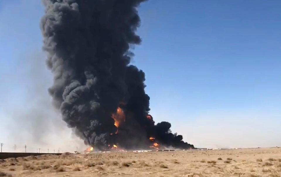 Smoke rises from fuel tankers at the Islam Qala border with Iran, in Herat Province, west of Kabul, Afghanistan. Taliban have taken control of Islam Qala crossing border in western Herat province (AP)