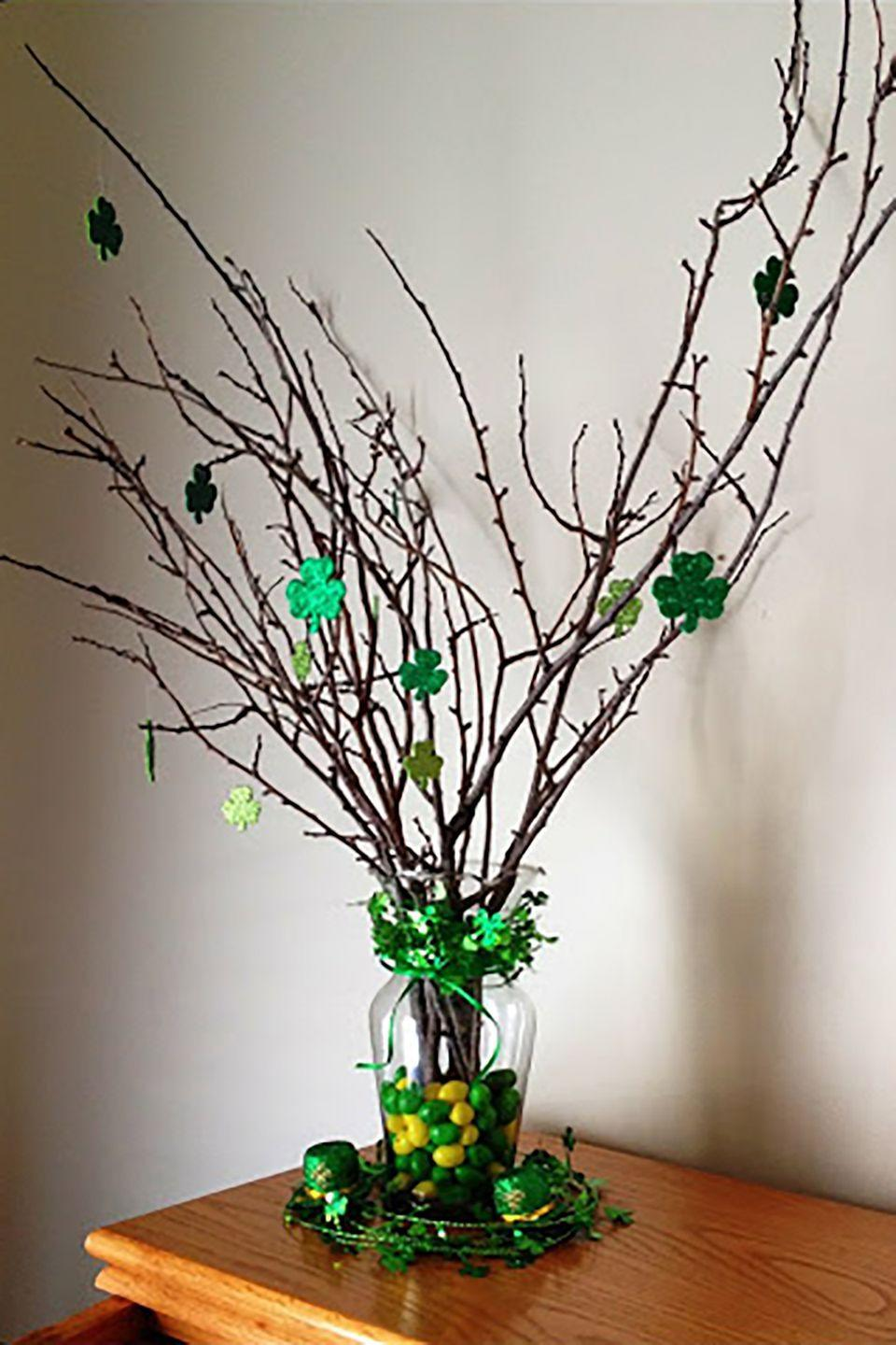 """<p>With some green and yellow jelly beans, glittery shamrocks, and twigs from outside, you can make this eye-catching decoration.</p><p><strong>Get the tutorial at <a href=""""http://itsmylifestorm.blogspot.com/2012/03/st-patricks-day-vase-deco.html"""" rel=""""nofollow noopener"""" target=""""_blank"""" data-ylk=""""slk:It's My Life, Storm"""" class=""""link rapid-noclick-resp"""">It's My Life, Storm</a>.</strong></p>"""